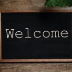 Welcome written on chalk blackboard