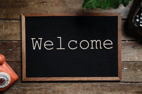 Welcome written on chalk blackboard