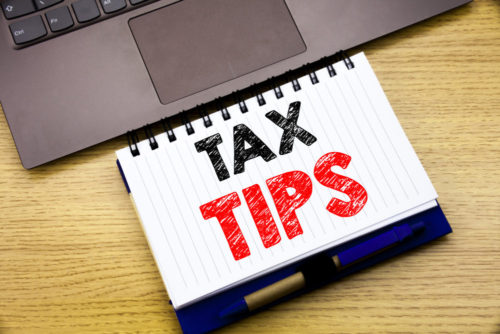 Hand writing text caption inspiration showing Tax Tips.